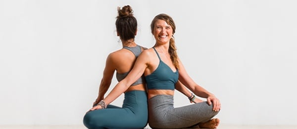 Easy Yoga Poses For Two People - Beginners Guide To Couples Yoga - seated twist